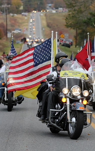 The Patriot Guard escort the precession for Staff SGT Chris Newman's memorial service.