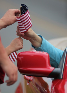 The crowd was handed flags to wave before the precession.