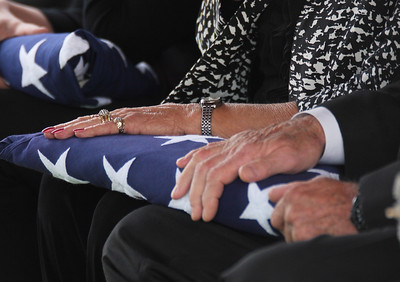 Grandparents Donald and Earlene Newman hold on to the flag presented to them.