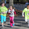 Trio: Runners Abby Wittenmyer, Jade Smith and Chantell Bender sprint the last 50 meters of the 1 Mile Fun Run Saturday morning at Hawthorne Park.
