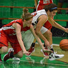 Tribune-Star/Jim Avelis<br /> All in: Centers Hannah Leee for Terre Haute South and Nicole Anderson for Terre Haute North scramble for the ball in first half action Saturday night.