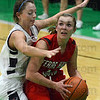 Tribune-Star/Jim Avelis<br /> Tapped: Terre Haute South giard Kayla Ennen looks for a team mate while Terre Haute North's Morgan Seeley applies the defense.