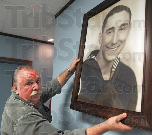 Wayne: Post 346 vice commander Stacie Wagle hangs a photograph of Wayne Newton as they prepare for Monday's grand opening event.