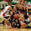 Tribune-Star/Jim Avelis<br /> High pressure system: South Vermillion's Karlie Crouch find herself the center of attention from Terre haute South's Clair bailey(22) and Tasia Brewer. Caught up in the action is Wildcat Morgan Samuelson.