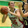 Tribune-Star/Jim Avelis<br /> In the middle: Terre Haute South center Hannah Lee looks to shoot around the defense of South Vermillion's Katelyn Freed.