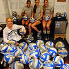 Tribune-Star/Jim Avelis<br /> Having a ball: Indiana State head volleyball coach Traci Dahl in her office with her three seniors: Kiya James, Stacy Qualizza and Shelbi Fouty.