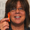 Tribune-Star/Jim Avelis<br /> Warm glow: Robin Heng of the Visiting Nurse Association/Hospice of the Wabash Valley holds an orange ribbon, the fundraising device to help the Light House Mission buy food baskets this Thanksgiving.