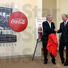 Tribune-Star/Joseph C. Garza<br /> Local art: Artist Bill Wolfe shakes hands with Dave Patterson, executive director of the Convention and Visitors Bureau, as fellow artist John Hemminghouse looks on after Wolfe and Hemminghouse unveiled the Coca-Cola piece they created to commemorate the birthplace of the Coca-Cola bottle, Terre Haute, Ind., Wednesday at the bureau.