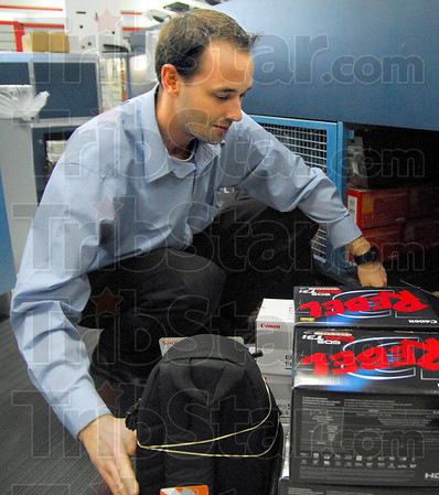 Rebel: H.H. Gregg electronics manager stocks Rebel cameras in preparation of coming holiday sales events Wednesday afternoon.