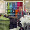 Preparation: JC Penny's sales associate Will Gardner stocks the shelves with towels Wednesday afternoon in preparation for Black Friday and other sales events.