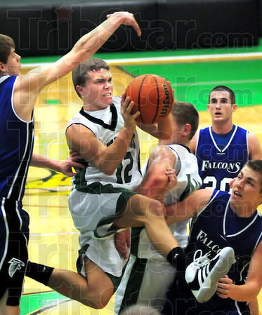 Houser hops: West Vigo point guard Jordan Houser drives the ball past North Vermillion defenders during game action Wednesday.