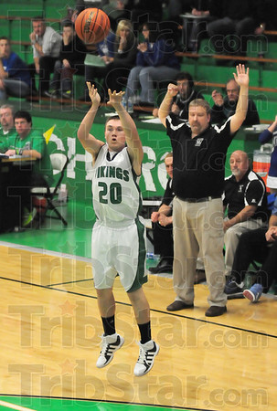 """For three: West Vigo's #20, Cade Lindsey launches and hits a three-point-shot durng game action against North Vermillion. North Vermillion coach Sam Karr calls it a """"three."""""""