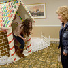 Tribune-Star/Joseph C. Garza<br /> Did you see Hansel?: After disappearing into the giant gingerbread house Wednesday at Westminster Village, Emilie Blythe reappears with what she went in for: a candy cane. Blythe, Sam Bunch, right, Esther Kim and Chris Nees paused to check out the giant candy-coated structure before having lunch with resident, Anne Riddle, Wednesday.
