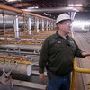 Tribune-Star/Joseph C. Garza<br /> How they heat 'em up: Mat Tramel, interim plant manager at Boral Brick, describes how the kiln system works at the plant Wednesday during a tour.