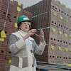 Tribune-Star/Joseph C. Garza<br /> The holes make them lighter: Boral Brick Director of Marketing Shelley Ross explains the manufacturing process for the company's products during a tour of the southern Vigo County plant Wednesday.