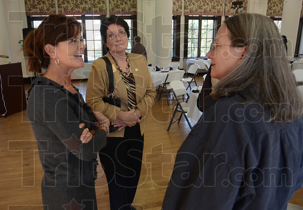 Tribune-Star/Jim Avelis<br /> Meet & Greet: St. Mary-of-the-Woods student Patricia Jones and SMWC employee Susan Dolle chat with Mellen O'Keefe after O'Keefe's presentation.