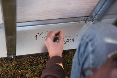Students and staff signing the last beam for the new Tucker Student Center