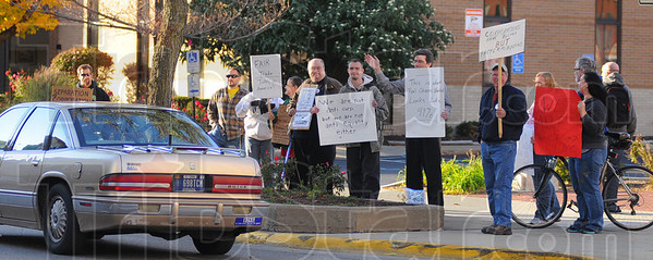 Tribune-Star/Jim Avelis<br /> Occupation therapy: About 15 citizens showed up at 7th and Wabash Monday evening for an Occupy Terre Haute rally.
