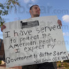 Tribune-Star/Jim Avelis<br /> Time served: Iraq veteran Jeff Butwin was one of about 15 Occupy Terre Haute demonstrators at 7th and Wabash Monday evening.