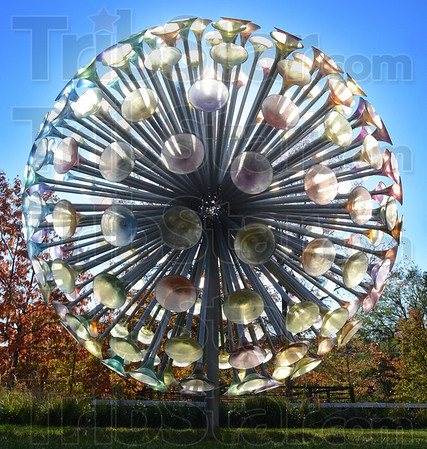 """Tribune-Star/Jim Avelis<br /> New addition: """"A Chorus of Trumpets"""" by Brooklyn sculptor Howard Kalish is composed of stainless steel, aluminum and tinted urethane. The work is now on display in Rankin Plaza on the Indiana State University ampus."""