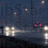 Pouring rain: Traffic travels at a slow pace along South 13th Street during a heavy downpour about 5:30 p.m. Monday evening.