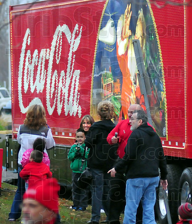 Coke photo: Several thousand people attended Monday's Coca-Cola celebration on the lawn of the Vigo County  Courthouse. Some posed for photographs with Santa's picture.