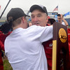 Tribune-Star/Joseph C. Garza<br /> Badgers take the title: Wisconsin coach Mick Byrne is hugged by Maverick Darling after the Badgers won the National Championship title at the NCAA cross country championships Monday at the Lavern Gibson Championship Cross Country Course.