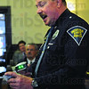 Scanned: Indiana State Police Master Trooper Gary Winters uses a scanning device to demonstrate the system that will be used by Terre Haute City Court.