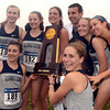 Tribune-Star/Joseph C. Garza<br /> Georgetown wins in Cross Country Town: Members of the Georgetown women's cross country team pose for photos with the NCAA National Champion trophy at the NCAA cross country championships Monday at the Lavern Gibson Championship Cross Country Course.