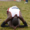 Tribune-Star/Joseph C. Garza<br /> Early thanksgiving: Arizona's Lawi Lalang kneels on the ground after he won the 10,000-meter men's race of the NCAA cross country championships Monday at the Lavern Gibson Championship Cross Country Course.