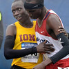 Tribune-Star/Joseph C. Garza<br /> Sportsmanship: Iona's Leonard Korir congratulates Arizona's Lawi Lalang after Lalang placed first in the men's race of the NCAA cross country championships Monday at the Lavern Gibson Championship Cross Country Course.