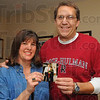 Tribune-Star/Jim Avelis<br /> Grads: Kymberli and Richard Payonk hold a photo of them together from her 1986 graduation from St. Mary-of-the-Woods. They celebrated their 25th reunions this year and have their 35th wedding anniversary next year.