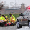 Moped crash: Honey Creek firefighters attend a man injured in a moped accident in the intersection of Springhill Road and Highway 63 Monday morning.