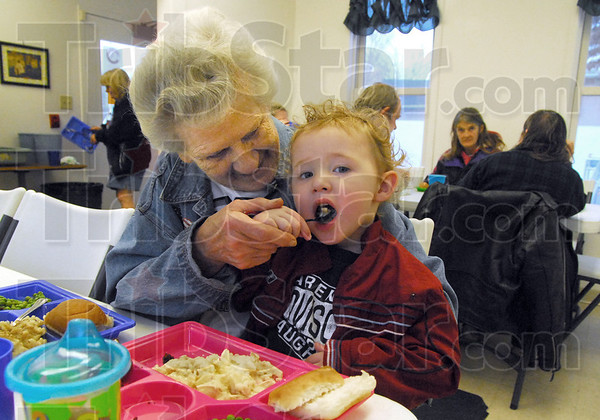Bethany baby: Two-year-old Noah Paitson gets fed by his great grandmother Linda Reeley Monday afternoon at the Bethany House Soup Kitchen.