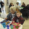 Soup kitchen: Linda Reeley and her great grandson, two-year-old Noah  Paitson eat lunch at the Bethany House Soup Kitchen Monday afternoon. The kitchen served 194 meals in one day last week.