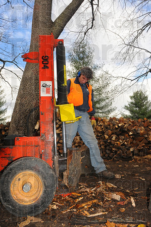 """Tribune-Star/Jim Avelis<br /> Renewable resource: A Terre Haute Parks Department employee Joe Crebb uses a hydraulic splitter Tuesday afternoon to make firewood at Deming Park. Parks superintendent Eddie bird said """"We don't want to take any trees out."""" The trees that get cut down are either dead, storm damaged or a hazard. They recently had to remove two huge cottonwoods from Fairbanks Park, one fell and the other was a threat to the boat dock."""