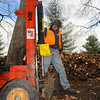 "Tribune-Star/Jim Avelis<br /> Renewable resource: A Terre Haute Parks Department employee Joe Crebb uses a hydraulic splitter Tuesday afternoon to make firewood at Deming Park. Parks superintendent Eddie bird said ""We don't want to take any trees out."" The trees that get cut down are either dead, storm damaged or a hazard. They recently had to remove two huge cottonwoods from Fairbanks Park, one fell and the other was a threat to the boat dock."