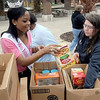 Tribune-Star/Joseph C. Garza<br /> More donations for a good cause: Indiana State University freshmen Ayanna Sykes of Terre Haute and Emily Fox of Madison pack donated food items during the Jam the Bus event Tuesday on the Indiana State campus.
