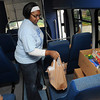 Tribune-Star/Joseph C. Garza<br /> Jammin' it: Indiana State junior and chair of the Community Service Committee Sharon Johnson of Bossier City, La., sits another donation on a bus seat during the Jam the Bus event Tuesday on the Indiana State campus.
