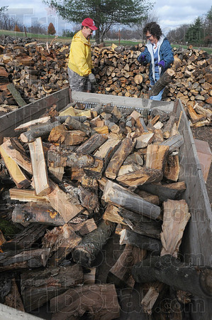 Tribune-Star/Jim Avelis<br /> Loading up: Jeff Layne and Kim Smith load their trailer with firewood from the Terre Haute Parks Department supply at Deming Park. The annual firewood sale is this Saturday from 9:00a.m. unitl 1:00p.m.