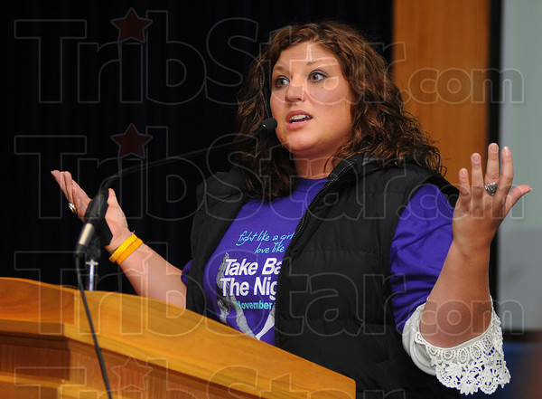 """Tribune-Star/Jim Avelis<br /> Victimized no more: Natalie Robbins, and ISU alum, recounts her years of abuse and how she broke free. She was one of the speakers at the """"Take Back the Night"""" march Tuesday night"""