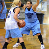Tribune-Star/Jim Avelis<br /> Getting ready: Chelsey Barron defends a SMWC teamate in practice in the old Clinton gym Tuesday afternoon.