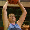 Tribune-Star/Jim Avelis<br /> On the boards: Chelsea Weaver works on her rebounding at the start of Saint-mary-of-the-Woods  practice Tuesday evening.