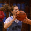 Tribune-Star/Jim Avelis<br /> Drills: Brittney Shaner works on the basics at the beginning of St. Mary-of-the-Woods basketball practice.