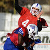 Tribune-Star/Jim Avelis<br /> Over the top: Indiana State quarterback Ronnie Fouch throws to the sidelines over teammate Shakir Bell as the Sycamore prepare for North Dakota State.