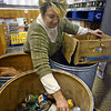 Food basket: Catholic Charities Food Bank operations coordinator Lori McKinley prepares a box of food for a local client Tuesday afternoon.