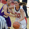 Tribune-Star/Jim Avelis<br /> Heavy traffic: Terre Haute South forward Claire Bailey tries to drive the baseline against the defense of Sullivan's Sierra Walters.