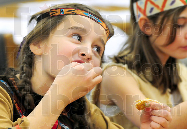 Finger food: Consolidated Elementary School fifth grader Natalie Mauk eats some Turkey during Tuesday's Thanksgiving dinner at the school.