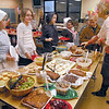 Feast: Consolidated Elementary School fifth grade teacher Teresa Stuckey (R) helps her kids with the Thanksgiving feast Tuesday afternoon at the westside school.