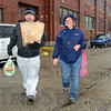 Tribune-Star/Jim Avelis<br /> Giving back: Light House Mission resident Phillip Runkel helps Michelle Amlett carry food to her vehicle. Amlett was one of hundreds who recieved Thanksgiving food baskets from the Mission.